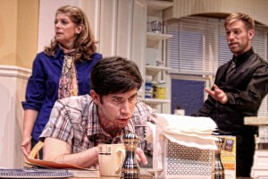 Kathleen Wattis (Elizabeth), Wyatt Fenner (Bailey), and Joe Sykes (Radio Voice/Death) in Pluto. Photo by BreeAnne Clowdus